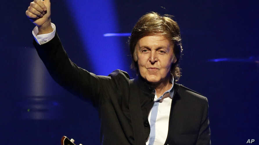 "Paul McCartney performs during the first U.S concert of his ""Out There!"" world tour in Orlando, Fla., May 18, 2013."