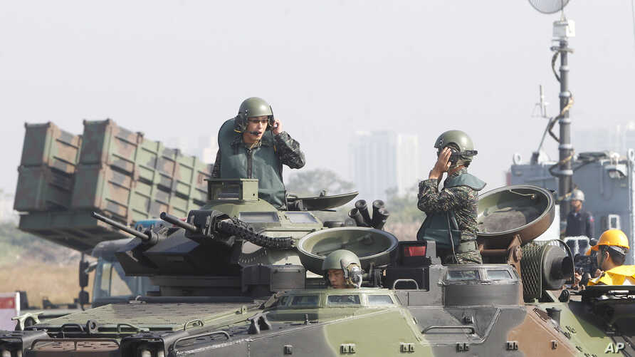 Soldiers on an amphibious assault vehicle communicate during military exercises at the Zuoying naval base in southern Taiwan, Jan. 18, 2017. Singapore and Taiwan will continue to carry out a military training program begun in 1975, Taiwan officials s