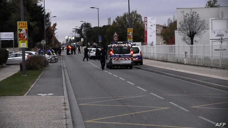 An image grab from an AFP TV video shows police vehicles in a street where a man rammed his car into a group of people in Blagnac, near the southern French city of Toulouse, Nov. 10, 2017, injuring one of them seriously, said justice officials, who i