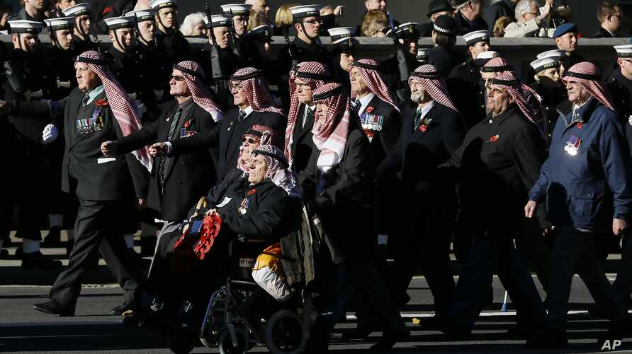 Veterans from the Oman Trucial Scouts process during the service of remembrance at the Cenotaph in Whitehall, London, Sunday, Nov. 10, 2013.
