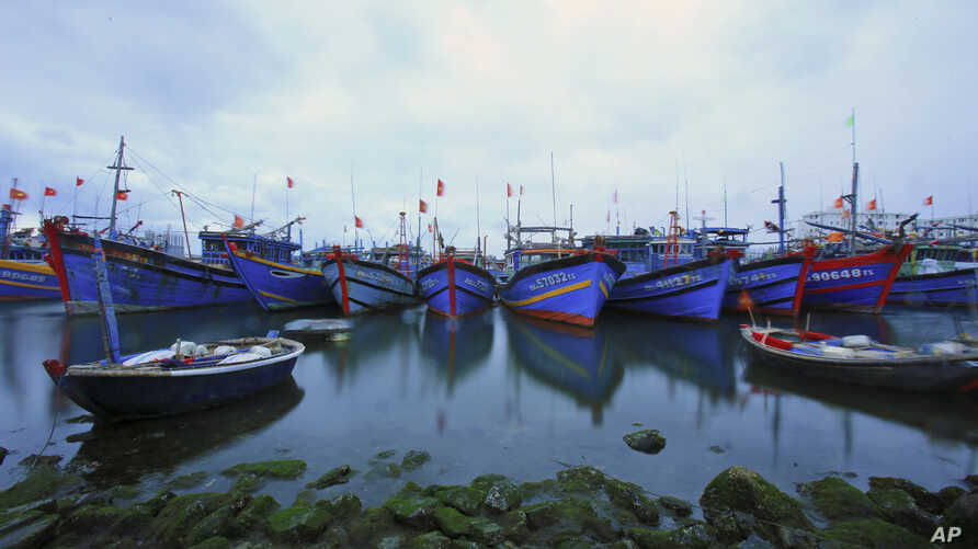 FILE - Fishing boats are docked in Tho Quang port, Danang, Vietnam.