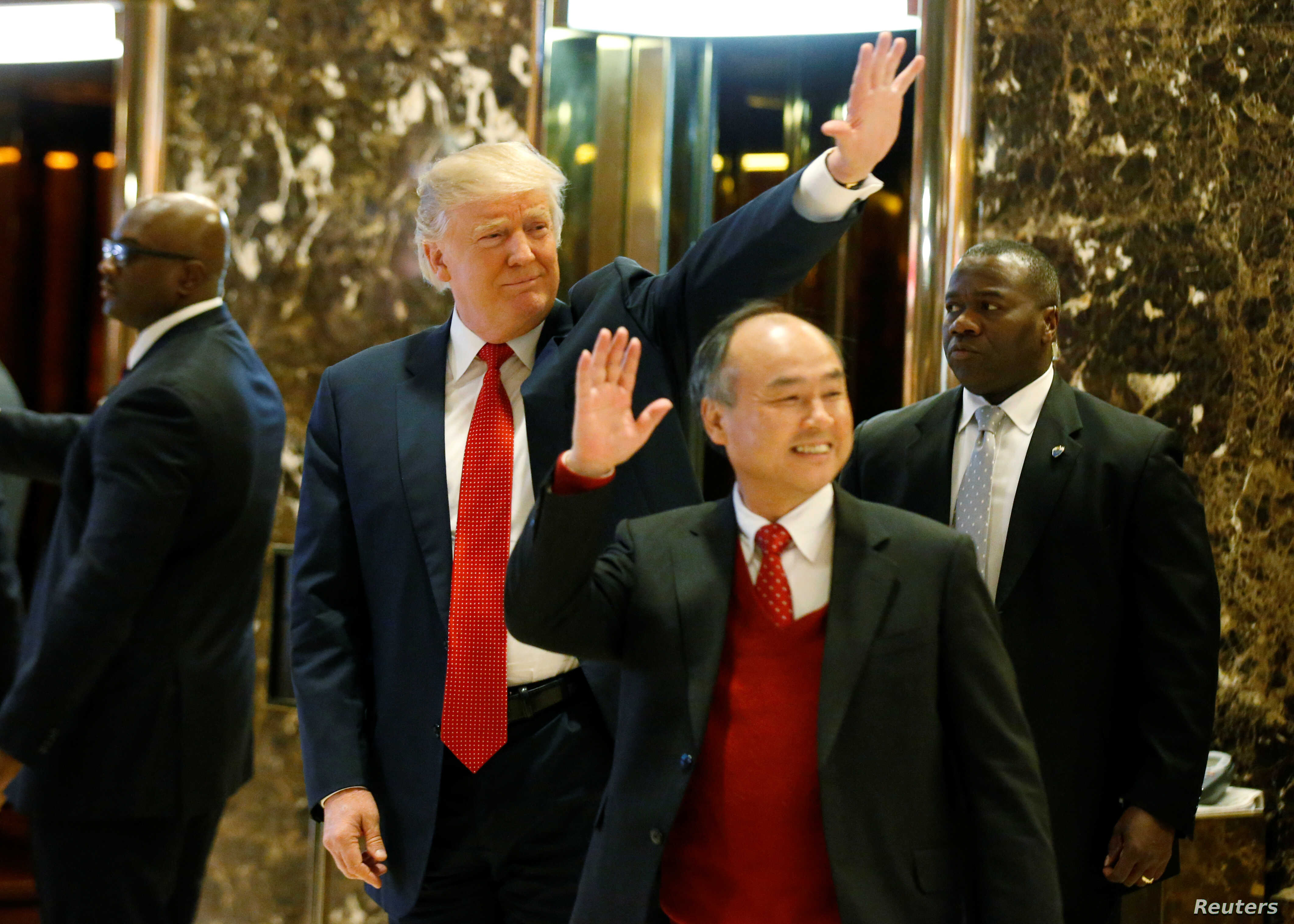 U.S. President-elect Donald Trump and Softbank CEO Masayoshi Son acknowledge guests after meeting at Trump Tower in Manhattan, New York City, Dec. 6, 2016.