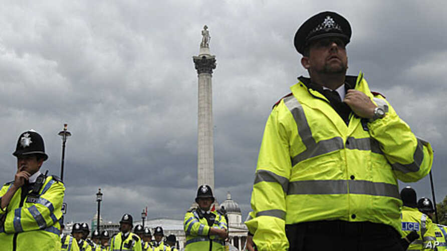Police officers in London during a June protest against government austerity measures (file photo).