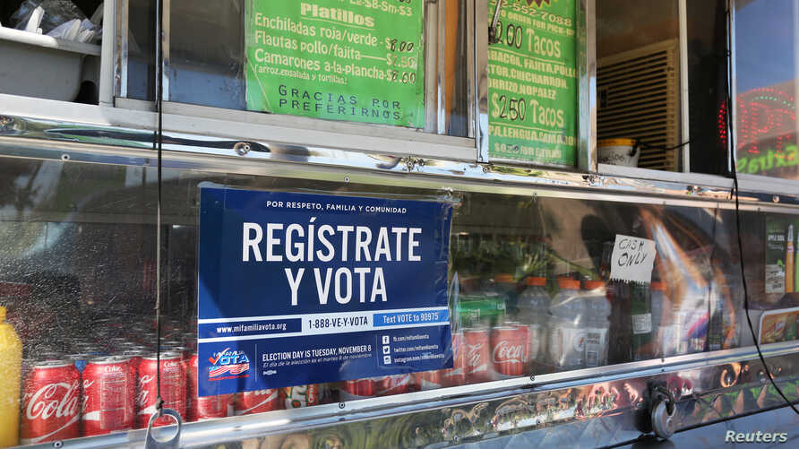 """A voter registration sign is seen on a taco truck, as part of the U.S. Hispanic Chamber of Commerce's """"Guac the Vote"""" campaign, in Houston, Texas, Sept. 29, 2016."""