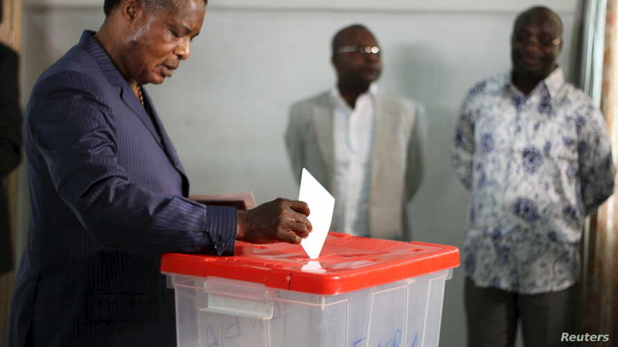 FILE - FILE - Republic of Congo President Denis Sassou Nguesso votes at a polling station in Brazzaville, Congo, Oct. 25, 2015.