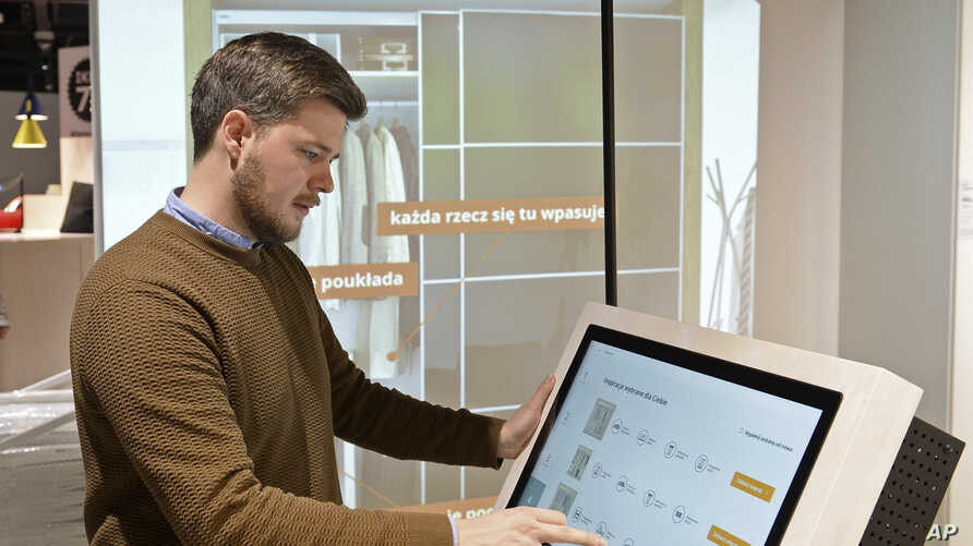 Andreas Flygare, the project manager for the new Warsaw Ikea store presents a system projecting furniture interior a wall, in Warsaw, Poland, Nov. 22, 2018.