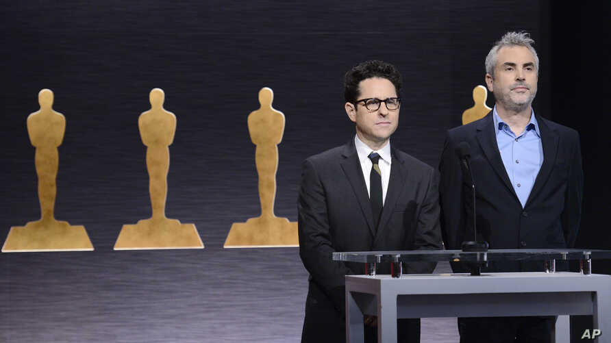 J.J. Abrams (l) and Alfonso Cuaron announce the Academy Awards nominations at the 87th Academy Awards nomination ceremony on Thursday, Jan. 15, 2015 in Beverly Hills.