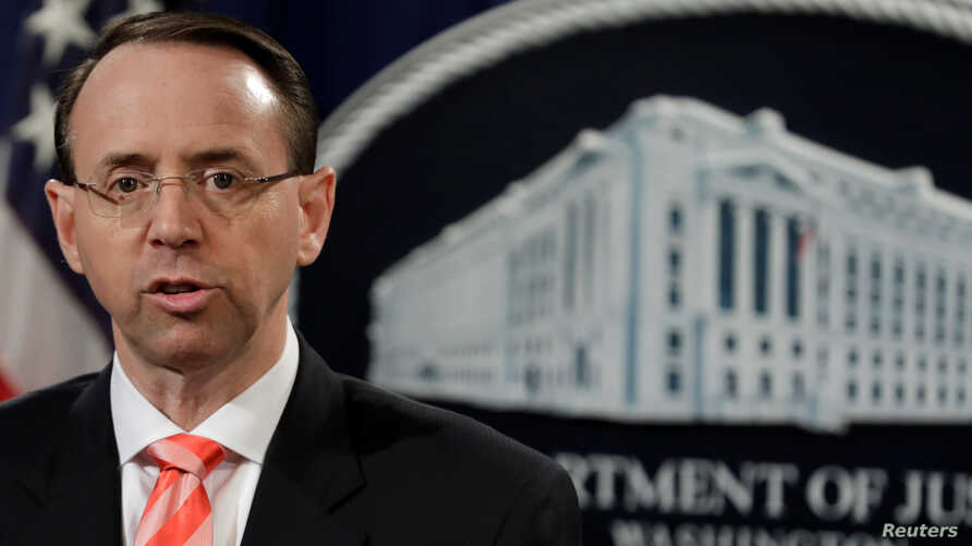 U.S. Deputy Attorney General Rod Rosenstein speaks at a news conference at the Justice Department in Washington, March 23, 2018.