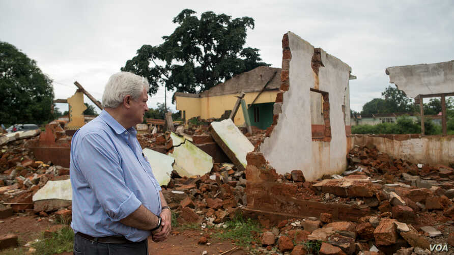 Stephen O'Brien, the U.N.'s top humanitarian official, looks over the main mosque in Bangassou, Central African Republic, that was burned down and destroyed during attacks involving the Christian anti-balaka in May.