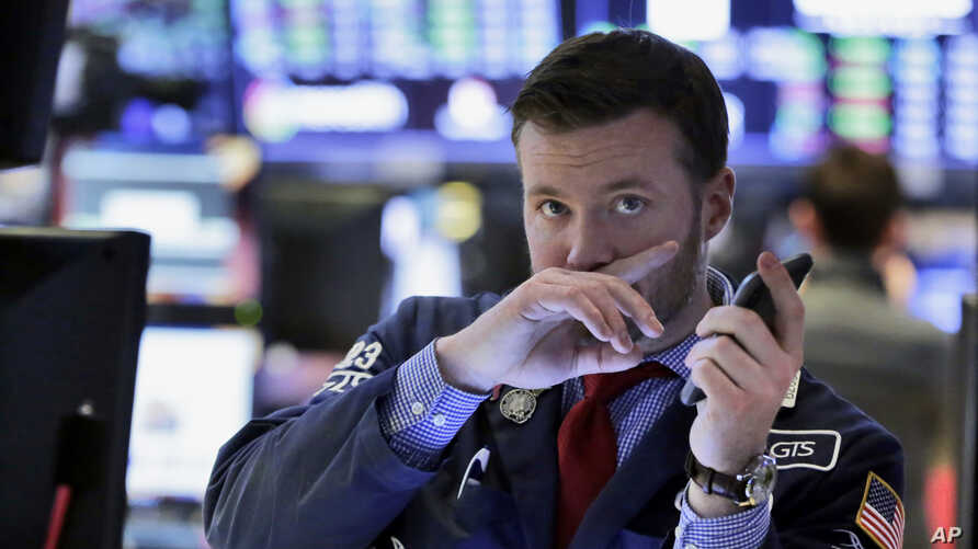 Trader Frank Masiello works on the floor of the New York Stock Exchange, Feb. 9, 2018. Stocks staged a late rally Friday, ending a wild week marked by dramatic point swings on a positive note.