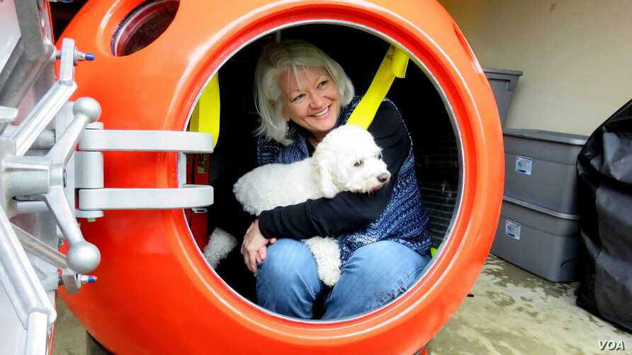 Jeanne Johnson plans to ride out a tsunami with her dog, Trixie, in Survival Capsule's tsunami pod.