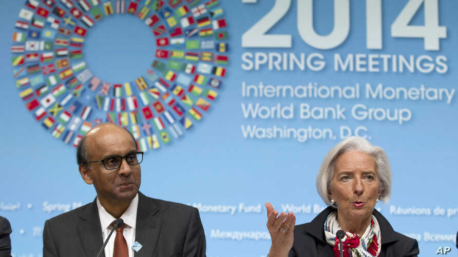 International Monetary Fund (IMF) Managing Director Christine Lagarde, accompanied by IMFC Chair and Singapore Finance Minister Tharman Shanmugaratnam, speaks during a news conference at World Bank Group-International Monetary Fund Spring Meetings in