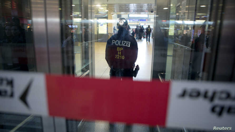 Police cordon off the luggage center at the railway station following a bomb alert, which turned out to be a hoax, in Hanover, Germany, Nov. 18, 2015.