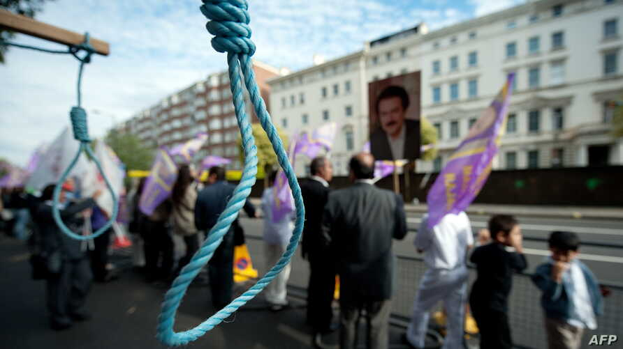 FILE - Mock nooses are displayed as supporters of the People's Mojahedin Organisation of Iran (PMOI) take part in a demonstration outside the Iranian embassy in west London on July 31, 2010 to draw attention to human rights abuses including punishmen