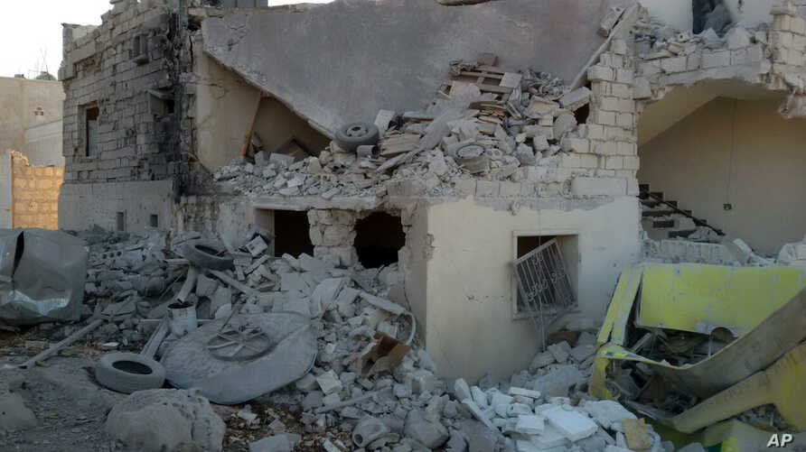 This photo provided by the Shafak Charity Organization, which has been authenticated based on its contents and other AP reporting, shows shows the badly damaged exterior of a medical facility dedicated to women after it was hit by four airstrikes tha
