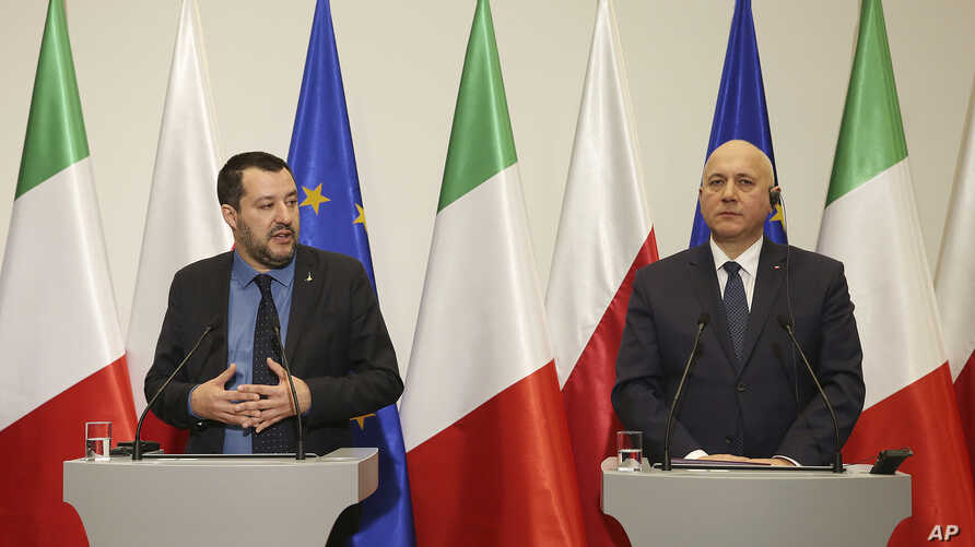 Italian Deputy Prime Minister Matteo Salvini, left, and Polish Interior Minister Joachim Brudzinski address the media following their talks in Warsaw, Poland, Jan. 9, 2019.
