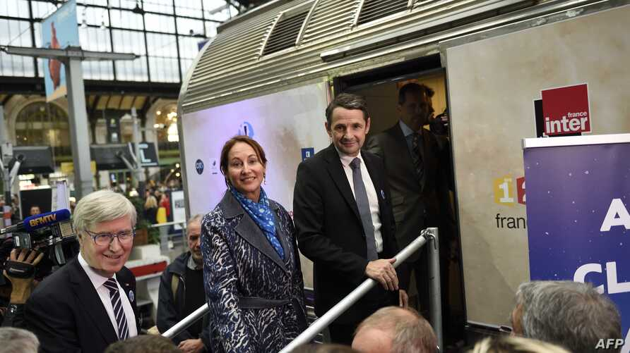 """French Environment Minister Segolene Royal and Junior Minister for State Reform Thierry Mandon attend the inauguration of the """"train du climat"""" (climate train) in Paris, Oct. 6, 2015."""