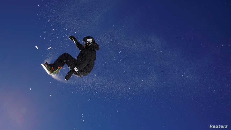 A snowboarder jumps during a training session on the Stubai glacier in Mutterberg, Austria, Nov. 3, 2017.