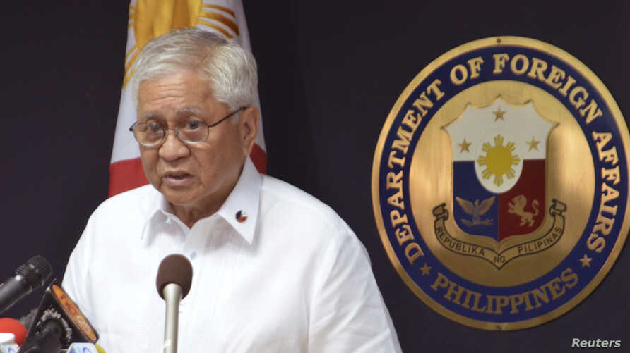 Philippine Foreign Affairs Secretary Albert Del Rosario speaks during a media briefing at the foreign affairs headquarters in this picture provided by the Department of Foreign Affairs in Manila January 22, 2013.
