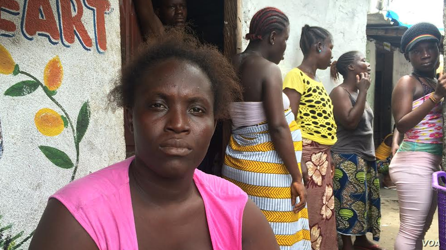 Ebola survivor Finda Fallah sits in front of her new room in West Point, Monrovia. (Benno Muchler/VOA)