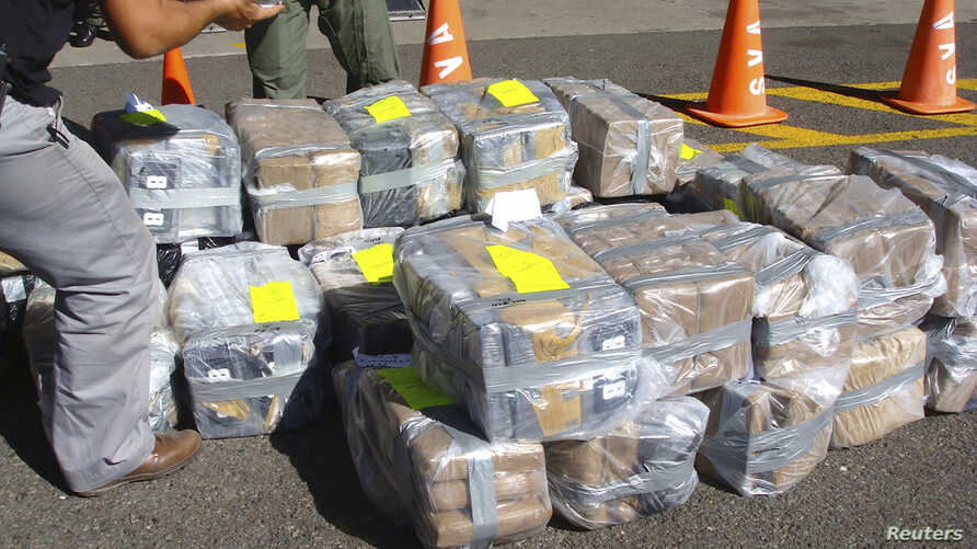 Costa Rican police officers guard about two tonnes of cocaine at the Juan Santa Maria International Airport in Alajuela February 1, 2012, in this handout photo provided by Costa Rica's Ministry of Public Security. Costa Rica's National Coast Guard Se