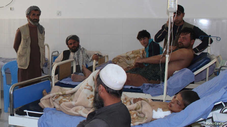 Afghans receive treatment at a hospital after Monday's airstrike in Kunduz province, Afghanistan, April 3, 2018.