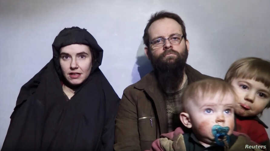 A still image from a video posted by the Taliban on social media on Dec. 19, 2016, shows American Caitlan Coleman speaking next to her Canadian husband, Joshua Boyle, and their two sons.