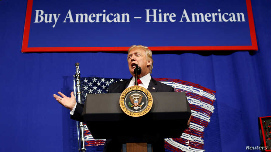 U.S. President Donald Trump speaks before signing an executive order directing federal agencies to recommend changes to a temporary visa program used to bring foreign workers to the United States to fill high-skilled jobs during a visit to Snap-On In
