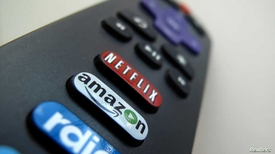 The Amazon TV button on a remote control is shown in this photo illustration, Nov. 10, 2017