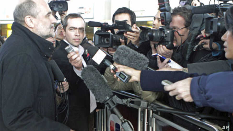 Herman Nackaerts (L), deputy director general of the International Atomic Energy Agency [IAEA] who headed the six-member IAEA mission to Iran, talks to journalists on his arrival from Tehran at the international airport in Vienna, February 1, 2012.