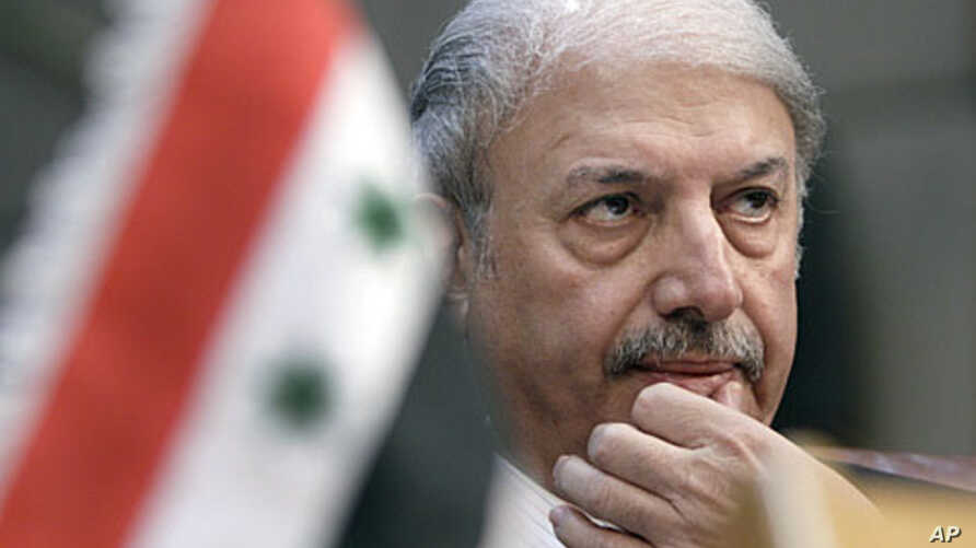 Yussef Ahmed, Syria's ambassador to the Arab League, looks on during the body's emergency session on Syria at the Arab League headquarters in Cairo, Egypt, November 12, 2011.