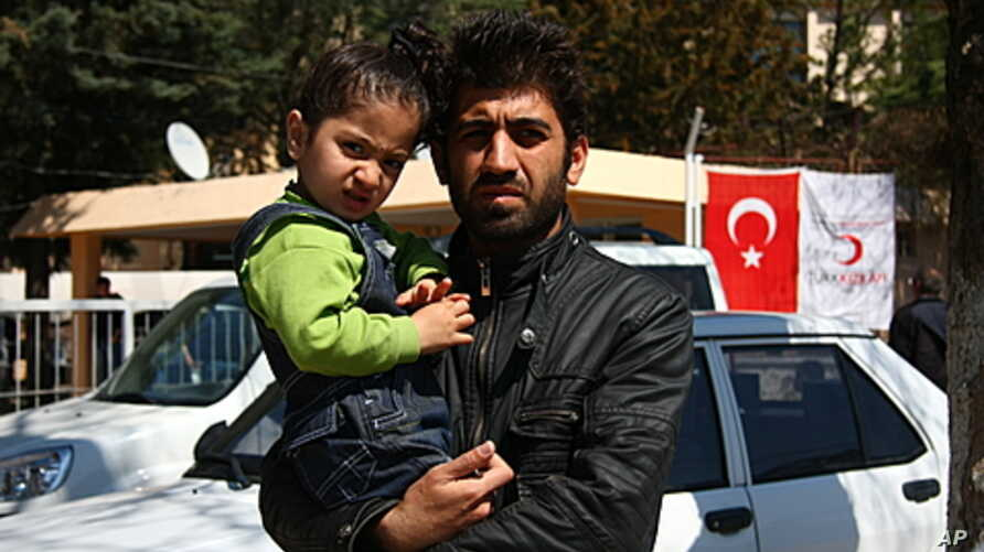 Ciwan, who would only give his first name because he has family still in Syria, escaped with his son from his hometown Idlib, Yayladagi, Turkey, March 22 , 2012.