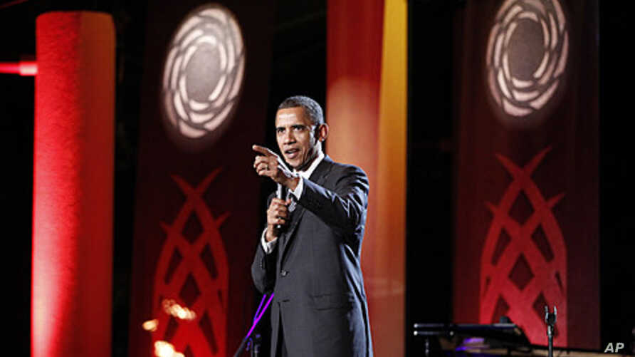 President Barack Obama speaks at a luau and entertainment portion of the leaders dinner at the APEC Summit in Honolulu, Hawaii, November 12, 2011.