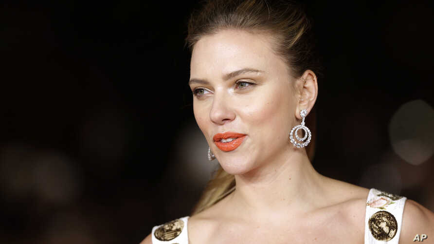 FILE - Actress Scarlett Johansson arrives for the screening of the film 'Her' at the 8th edition of the Rome International Film Festival in Rome, Nov. 10, 2013.
