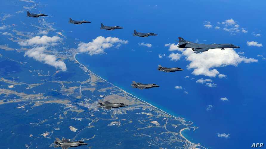 This handout photo taken Sept. 18, 2017 and provided by the South Korean Defense Ministry in Seoul shows U.S. and South Korean fighter jets flying over South Korea during a joint military drill aimed to counter North Korea's latest nuclear and missil