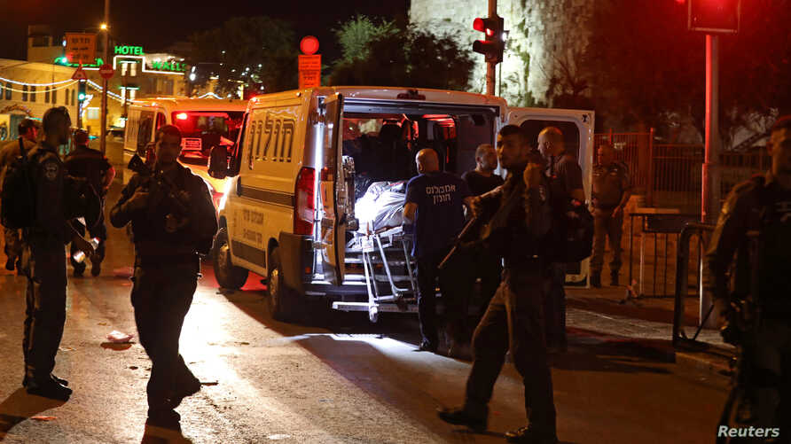 Israeli emergency personnel carry the body of one of three Palestinians who carried out shooting and stabbing attacks that fatally injured an Israeli border policewoman outside Damascus gate to Jerusalem's Old City June 16, 2017.