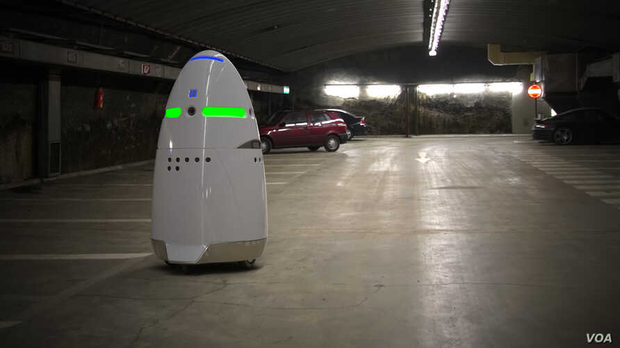 This photo from California manufacturer Knightscope shows the company's K5 security robot, keeping tabs on a parking area.
