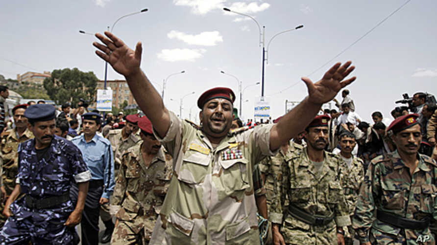 Yemeni army soldiers, who defected, join a demonstration demanding the resignation of President Ali Abdullah Saleh in Sana'a, September 16, 2011.