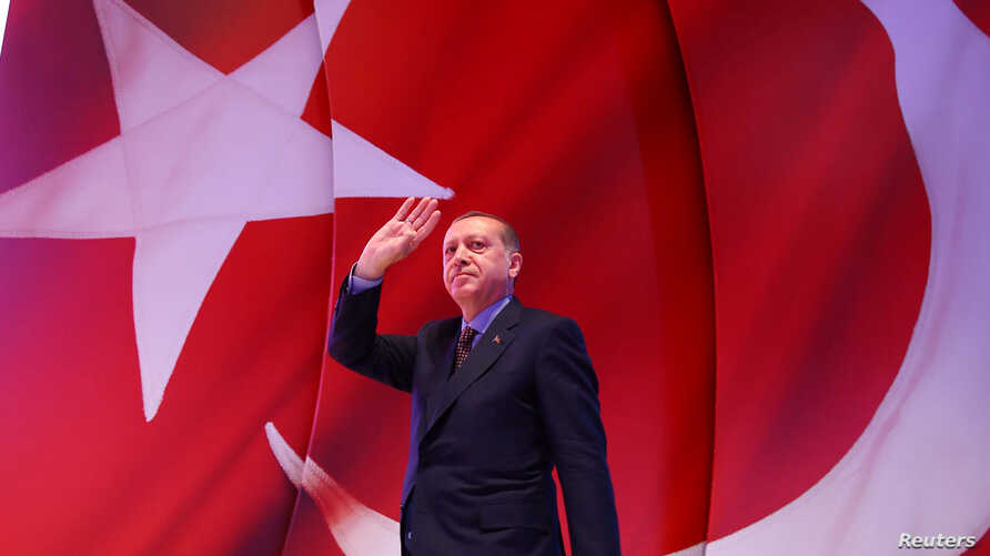 Turkish President Tayyip Erdogan greets his supporters during an event ahead of the constitutional referendum in Istanbul, Turkey April 12, 2017.