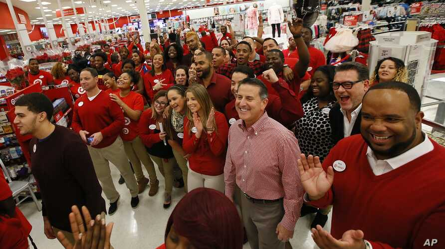 Target CEO, Brian Cornell, joins store team members before the Thanksgiving opening, Nov. 24, 2016, in Jersey City, N.J.