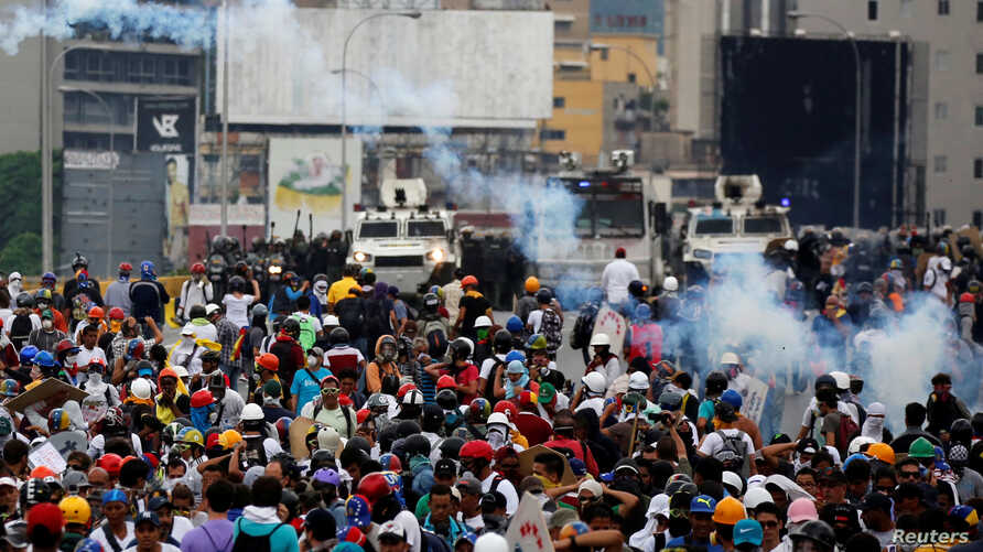 Opposition supporters clash with riot police during a rally against President Nicolas Maduro in Caracas, Venezuela, May 8, 2017.