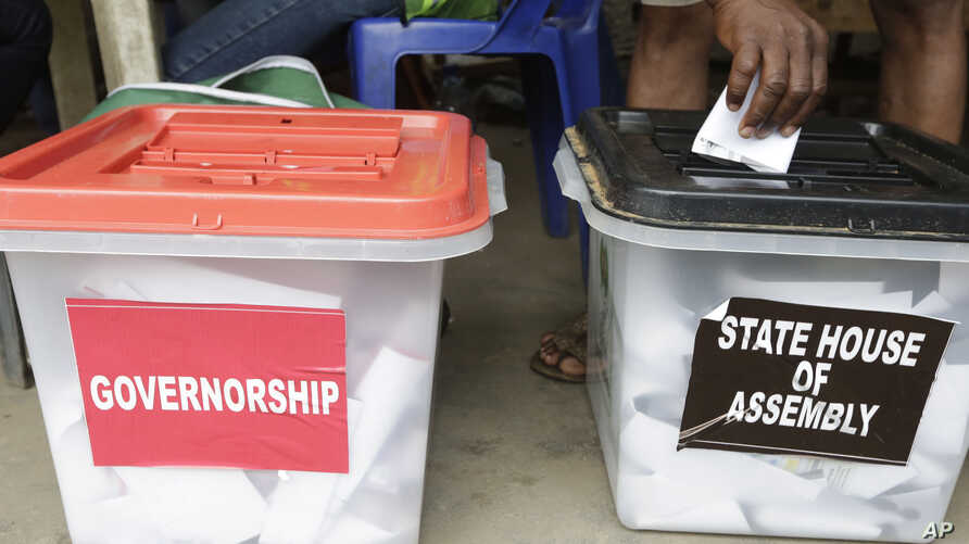 FILE - A man casts a ballot in Lagos, Nigeria, April 11, 2015.