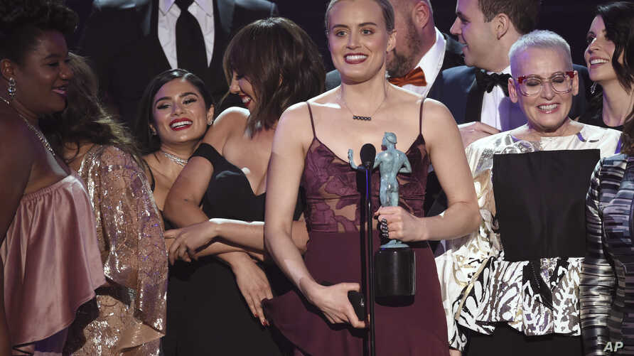 """Taylor Schilling and the cast of """"Orange Is the New Black"""" accept the award for outstanding performance by an ensemble in a comedy series at the 23rd annual Screen Actors Guild Awards, Jan. 29, 2017, in Los Angeles."""