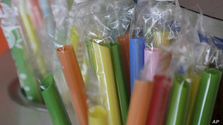 FILE - Wrapped plastic straws at a bubble tea cafe in San Francisco, July 17, 2018. A law signed Thursday by Gov. Jerry Brown makes California the first state to bar full-service restaurants from automatically giving out single-use plastic straws. It