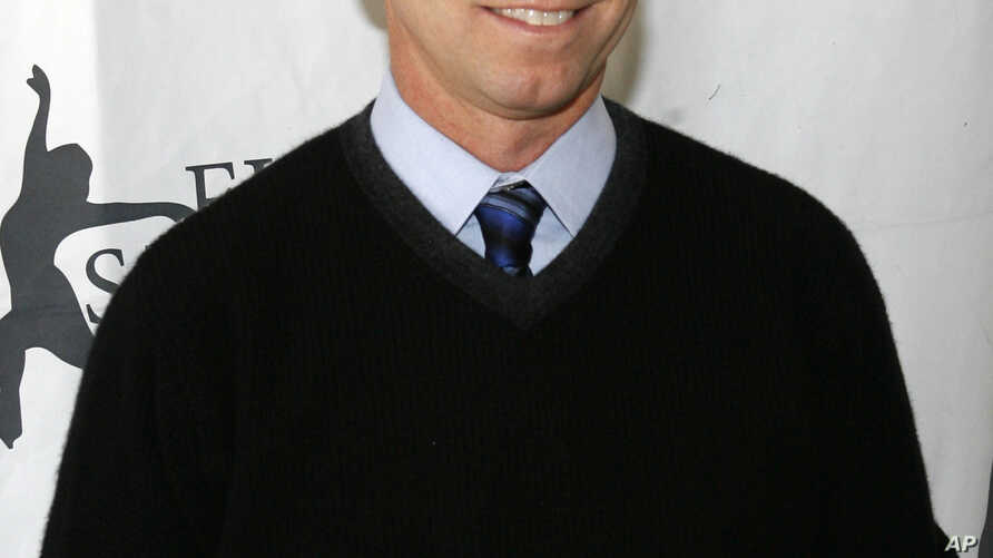 """FILE - Former Olympic figure skating gold medalist Scott Hamilton arrives for Figure Skating In Harlem's annual gala """"Skating with the Stars"""" at Central Park's Wollman Rink in New York."""