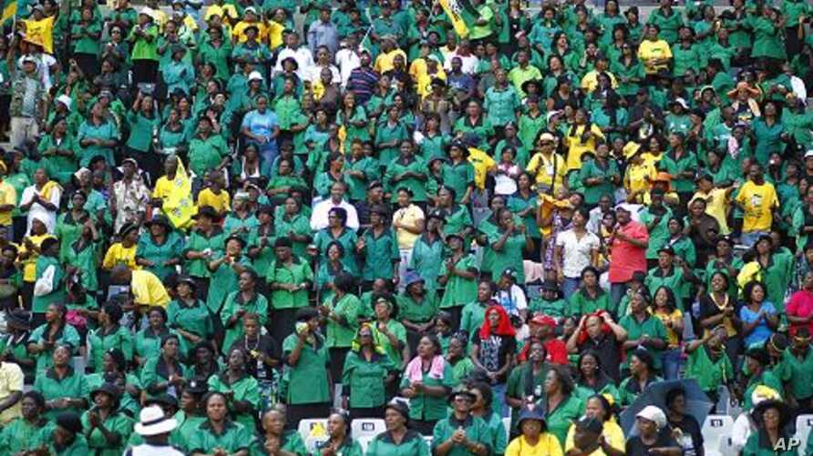 African National Congress supporters cheer before the start of their party's 100th anniversary celebrations in Bloemfontein, South Africa, January 8, 2012.
