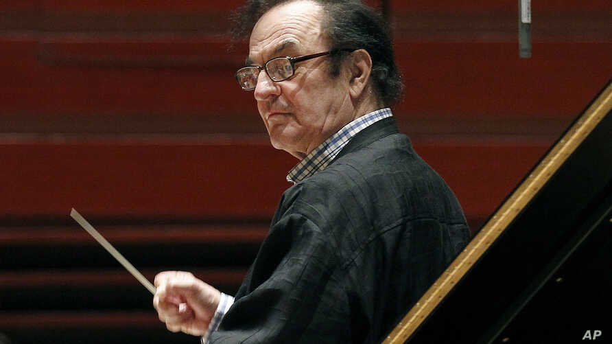 FILE - Chief conductor Charles Dutoit rehearses with the Philadelphia Orchestra in Philadelphia, Oct. 19, 2011.