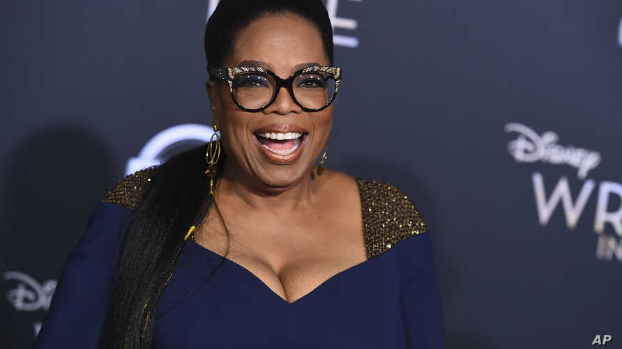 """Oprah Winfrey arrives at the world premiere of """"A Wrinkle in Time"""" at the El Capitan Theatre in Los Angeles, Feb. 26, 2018."""