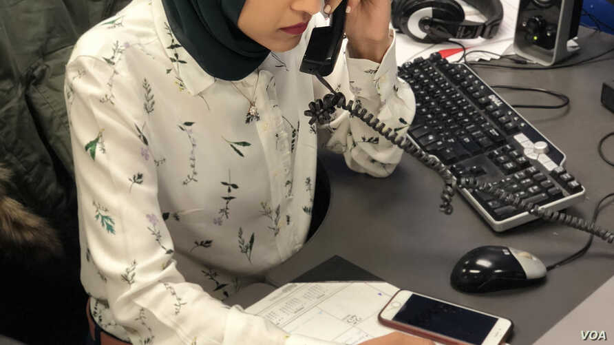 WHBF-TV Reporter Tahera Rahman works the phones to set up a potential news story.