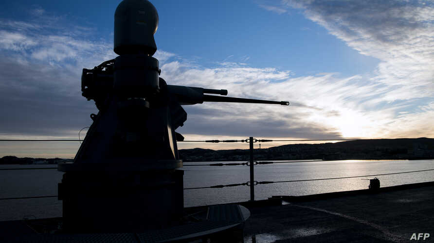 A general view of USS Mount Whitney of the US Navy at sunrise as it approaches the port during the NATO-led military exercise Trident Juncture, Nov. 3, in Trondheim, Norway.